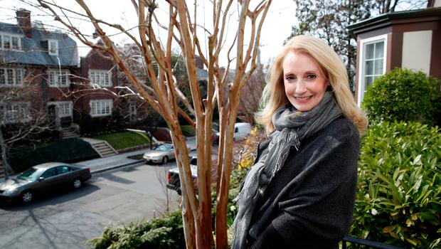 Rhona Wolfe Friedman poses for a picture in front of her home which is next door to the home of Ivanka Trump, Friday, March 24, 2017, in Washington. Residents of a posh Washington neighborhood say the Trump clan doesn't make for very good neighbors, hogging parking on an already crowded street and leaving trash bags rotting on the curb. A big part of the complaint: a huge security presence, with even a trip to the playground requiring three vans.   (AP Photo/Alex Brandon)
