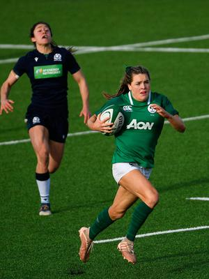Ireland's Beibhinn Parsons on her way to scoring her side's third try during the Women's Six Nations Rugby Championship win over Scotland at Energia Park in Donnybrook, Dublin. Photo: Ramsey Cardy/Sportsfile