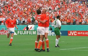 Dennis Bergkamp of Holland is congratulated by team-mate Marc Overmars on scoring their side's goal as Terry Phelan of Ireland looks on during the FIFA World Cup Finals, Round of 16 match. Photo by David Maher/SPORTSFILE
