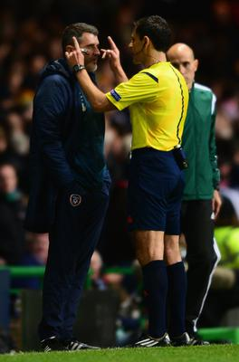 Referee Milorad Mazic speaks to Roy Keane assistant manager of the Republic of Ireland during the EURO 2016 Group D Qualifier match between Scotland and Republic of Ireland at Celtic Park