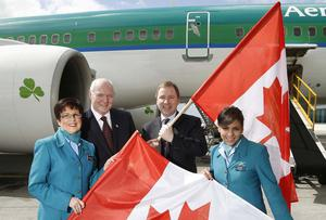 Cormac O'Connell,DAA General Manager Customer Relationship and Stephen Kavanagh, AerLingus Chief Strategy and Planning Officer with cabin crew Catherine Connolly and Ana Corpas (right)