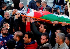 ATTENTION EDITORS - VISUAL COVERAGE OF SCENE OF DEATH    Mourners carry the body of Palestinian Maher Aljabi, 56, whom medics said was shot and killed by Israeli troops on Saturday, during his funeral in the West Bank city of Nablus December 27, 2015.   REUTERS/Abed Omar Qusini    TEMPLATE OUT