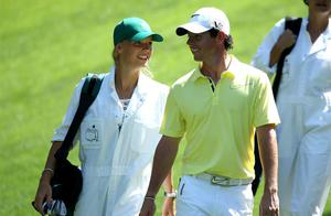 Rory McIlroy of Northern Ireland walks with his caddie Caroline Wozniacki during the Par 3 Contest. Photo: Getty Images