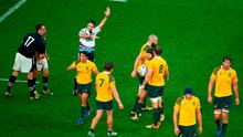Referee Craig Joubert awards Australia a late match winning penalty during the 2015 Rugby World Cup Quarter Final match between Australia and Scotland at Twickenham Stadium on October 18, 2015 in London, United Kingdom.  (Photo by Mike Hewitt/Getty Images)