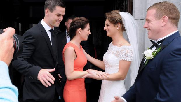 12/6/2015  Johhny Sexton and Wife Laura greet Claire Mulcahy and Sean Cronin after the ceremony. St. Josephs Catholic Church, Castleconnell, Co. Limerick.  Pic: Gareth Williams / Press 22