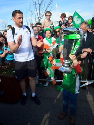 22/03/2015 Jamie Heaslip with Irish fan Aidan Shanagher 4 from Dundrum after the Irish Rugby side  arrived  at Dublin Airport following their 6 Nations Championship win  Photo:  Gareth Chaney Collins