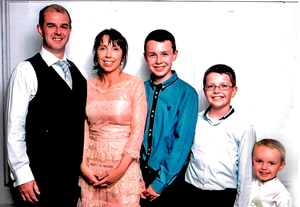 Alan Hawe with his wife Clodagh and their children Liam (15), Niall (11) and Ryan (6)