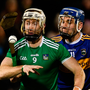 Cian Lynch of Limerick battling Tipp's John McGrath in Division 1 of the NHL – away from hurling strongholds the sport struggles to keep pace. Photo: Sportsfile