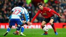 Marouane Fellaini battles for possession with Omar Richards of Reading last month. Photo: Getty Images