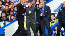 Arsenal boss Arsene Wenger and Chelsea manager Jose Mourinho get caught up in a heated exchange during the Premier League game at Stamford Bridge. Photo: Nick Potts/PA Wire