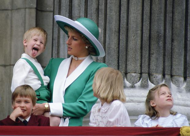 The old photos show cheeky Prince Harry sticking his tongue out at the event