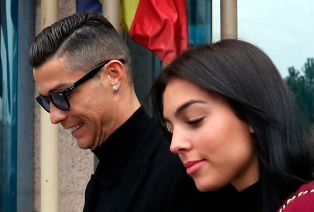Portugal's soccer player Cristiano Ronaldo leaves with his girlfriend Georgina Rodriguez after appearing in court on a trial for tax fraud in Madrid, Spain, January 22, 2019. REUTERS/Susana Vera