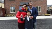 Key to happiness: Venkat, Ambica and their son Gautam Akkapelli are ready to move in. Photo: Adrian Donohoe