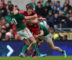 Ireland's Jonathan Sexton and Wales's Liam Williams during the RBS 6 Nations match at the Aviva Stadium