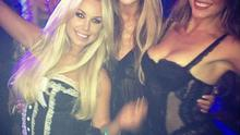 The three girls tweeted this photo of them living it up in Hef's LA mansion. (Credit:Twitter)