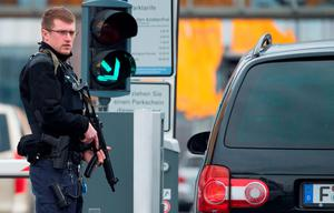 An armed policeman secures the access to the terminal area of the Frankfurt Airport, on March 22, 2016, in Frankfurt, western Germany. AFP PHOTO / DPA / Boris Roessler / Germany OUTBORIS ROESSLER/AFP/Getty Images