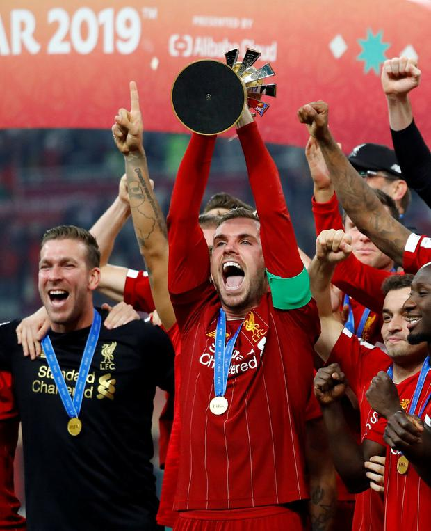 Liverpool's Jordan Henderson celebrates winning the Club World Cup with the trophy. Photo: Corinna Kern/Reuters
