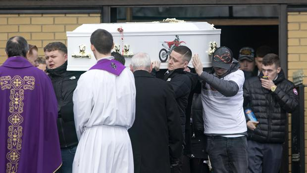 Last journey: Keane's coffin is carried out of the church. Photo: Colin Keegan, Collins Dublin