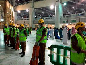 In this image released by the Saudi Interior Ministrys General Directorate of Civil Defense, an area is cordoned off at the Grand Mosque in Mecca after a crane collapsed killing dozens, Friday, Sept. 11, 2015. The accident happened as pilgrims from around the world converged on the city, Islam's holiest site, for the annual Hajj pilgrimage, which takes place this month. (Saudi Interior Ministry General Directorate of Civil Defense via AP)