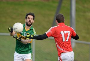 Kerry's Paul Galvin, left, in action against John Hayes, Cork