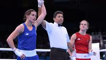 24 June 2015; Katie Taylor, Ireland, is announced victorious over Ida Lundblad, Sweden, by referee Jones Kennedy Silva do Rosario, following their Women's Boxing Light 60kg Quarter Final bout. 2015 European Games, Crystal Hall, Baku, Azerbaijan Picture credit: Stephen McCarthy / SPORTSFILE