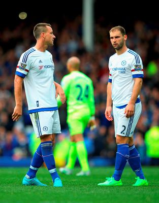 John Terry and Branislav Ivanovic of Chelsea look dejected after the Barclays Premier League match between Everton and Chelsea at Goodison Park