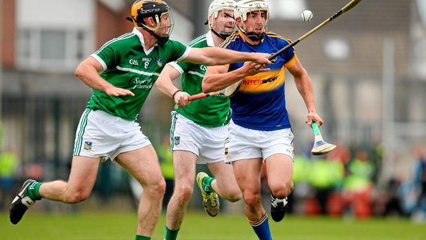 Patrick 'Bonner' Maher of Tipperary in action against James Ryan (left) and Tom Condon of Limerick.