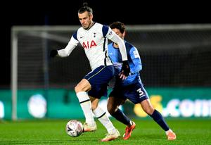 Tottenham's Gareth Bale of Tottenham Hotspur keeps possession from Wycombe's Joe Jacobson. Photo: Getty Images