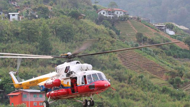 A helicopter leaves Kundasang, Malaysia for Mount Kinabalu to recover the bodies of climbers Saturday, June 6, 2015.  (Munehiro Yamaoka/Kyodo News via AP)