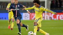 Chelsea attacker Willian is closed down by Paris Saint-Germain's Gregory Van der Wiel during their Champions League encounter last season.
