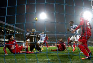 Charlie Austin heads in Queens Park Rangers' winning goal during their Premier League clash with Leicester City at Loftus Road. Photo: Nick Potts/PA Wire