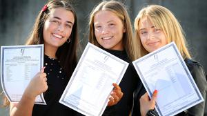 Leaving Cert results: Students Beth Clarke, Saoirse Mangan and Heidi Doris all from Dun Laoghaire celebrate as they collect their results from Rockford Manor Presentation School in Blackrock. Photo: Steve Humphreys