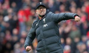 Jurgen Klopp strikes a familiar pose during Liverpool's march to Premier League glory this season. Photo: Alex Livesey - Danehouse/Getty Images