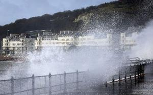 Waves crash over the promenade in Dover, Kent, as more bad weather and storms sweep across the country. Gareth Fuller/PA Wire