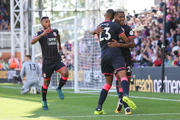 LONDON, ENGLAND - AUGUST 12: Steve Mounie of Huddersfield Town celebrates after scoring a goal to make it 0-3 during the Premier League match between Crystal Palace and Huddersfield Town at Selhurst Park on August 12, 2017 in London, England. (Photo by Robbie Jay Barratt - AMA/Getty Images)