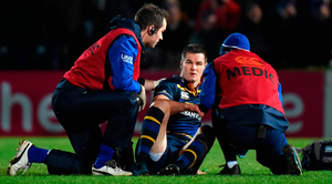 Johnny Sexton is seen by medics during the first half Photo: Matt Browne/Sportsfile
