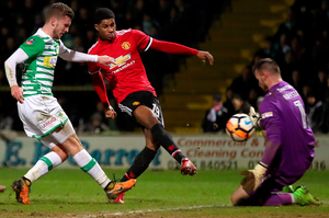 Marcus Rashford pounces on hesitation in the Yeovil defence to open the scoring for Manchester United. Photo: PA