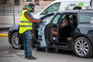 A man cleans and desinfects a taxi car in central Stockholm, Sweden to prevent the spread of the coronavirus  (Photo by ANDERS WIKLUND/TT News Agency/AFP via Getty Images)