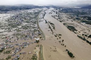 An aerial view shows residential areas flooded by the Chikuma river following Typhoon Hagibis in Nagano, central Japan, October 13, 2019, in this photo taken by Kyodo. Mandatory credit Kyodo/via REUTERS