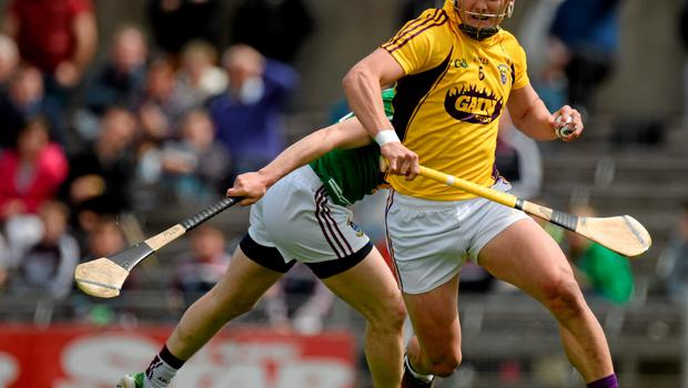 Wexford's Lee Chin bursts past Niall Dowdall, Westmeath