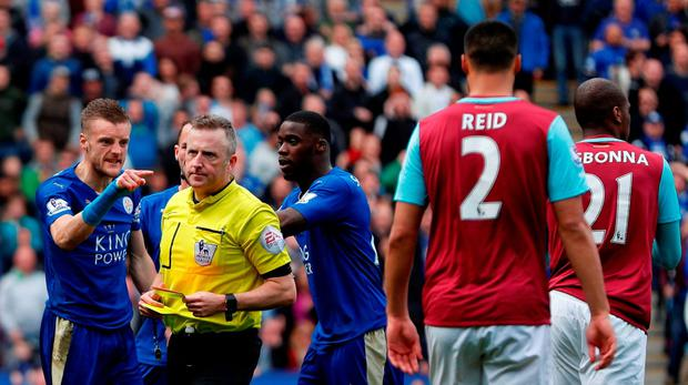 Leicester City striker Jamie Vardy (L) reacts after referee Jonathan Moss (2L) showed Vardy his second yellow card for simulation to send him off during the English Premier League football match between Leicester City and West Ham United at King Power Stadium