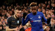 Chelsea's Callum Hudson-Odoi is tackled by Sheffield Wednesday's Barry Bannan at Stamford Bridge yesterday. Photo: Reuters