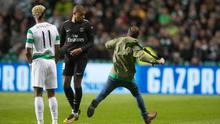 GLASGOW, SCOTLAND - SEPTEMBER 12: Celtic fan ran on the pitch and aimed a kick at Kylian Mbappe of Paris Saint Germain during the UEFA Champions League Match  between Celtic and Paris Saint Germain at Celtic Park Stadium on September 12, 2017 in Glasgow, Scotland. (Photo by Steve Welsh/Getty Images)