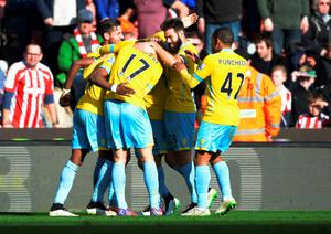 STOKE ON TRENT, ENGLAND - MARCH 21:  Wilfried Zaha of Crystal Palace celebrates scoring their second goal with team mates during the Barclays Premier League match between Stoke City and Crystal Palace at Britannia Stadium on March 21, 2015 in Stoke on Trent, England.  (Photo by Gareth Copley/Getty Images)