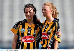 14 September 2014; Dejected Kilkenny players Therese Muldowney, left, and Stacey Quirke after the game. All Ireland Intermediate Camogie Championship Final, Kilkenny v Limerick, Croke Park, Dublin. Picture credit: Ramsey Cardy / SPORTSFILE