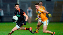Armagh's Rory Grugan evades the challenge of Antrim's Conor Hamill at the Athletic Grounds last night. Photo: Oliver McVeigh/Sportsfile