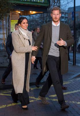 LONDON, ENGLAND - JANUARY 09:  Prince Harry and Meghan Markle leave after visiting Reprezent 107.3FM on January 9, 2018 in London, England. The Reprezent training programme was established in Peckham in 2008, in response to the alarming rise in knife crime, to help young people develop and socialise through radio.  (Photo by Dominic Lipinski - WPA Pool /Getty Images)