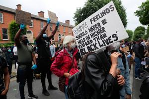 People take part in a Black Lives Matter protest rally outside the US embassy in Dublin, in memory of George Floyd who was killed on May 25 while in police custody in the US city of Minneapolis. PA Photo. Picture date: Saturday June 6, 2020. See PA story POLICE Floyd. Photo credit should read: Brian Lawless/PA Wire