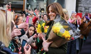 Flower girl: Kate meets the public during the walkabout in Galway city centre. Photo: Gerry Mooney