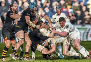 Jimmy Gopperth, with the support of his Leinster team-mates Fergus McFadden, below, and Tadhg Furlong, right, is tackled by Nathan Hughes of Wasps at the Ricoh Arena in Coventry yesterday